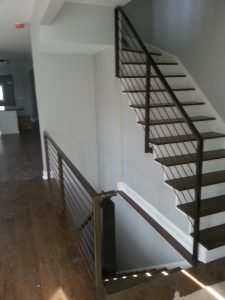 Upper and lower staircases with rails