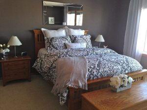 Master bedroom with purple comforter