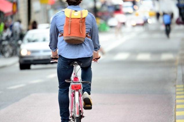 Commuter on bike in traffic