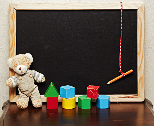 blackboard with bear and blocks