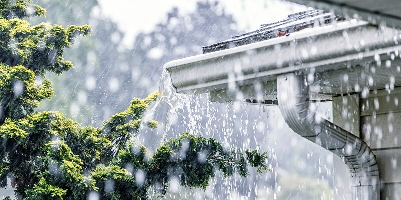 aluminum gutters full of rain