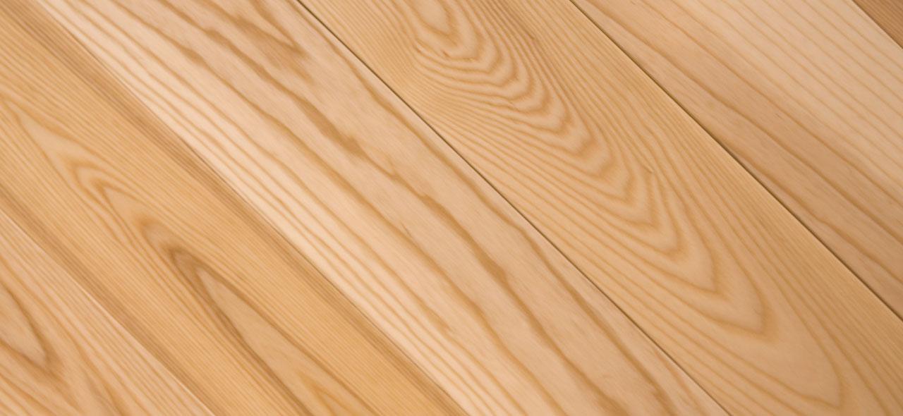Ash hardwood flooring texture closeup.