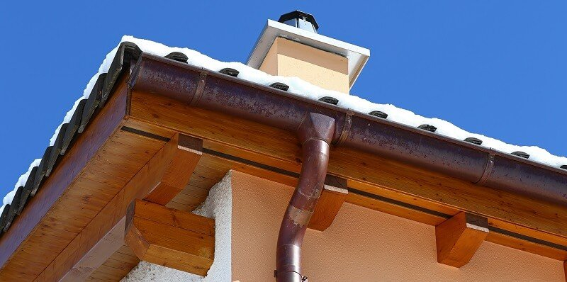 copper gutter off a snowy, residential roof