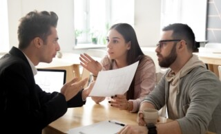 Angry couple disputing about mortgage or construction with lawye