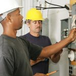 two men hired for electrical work