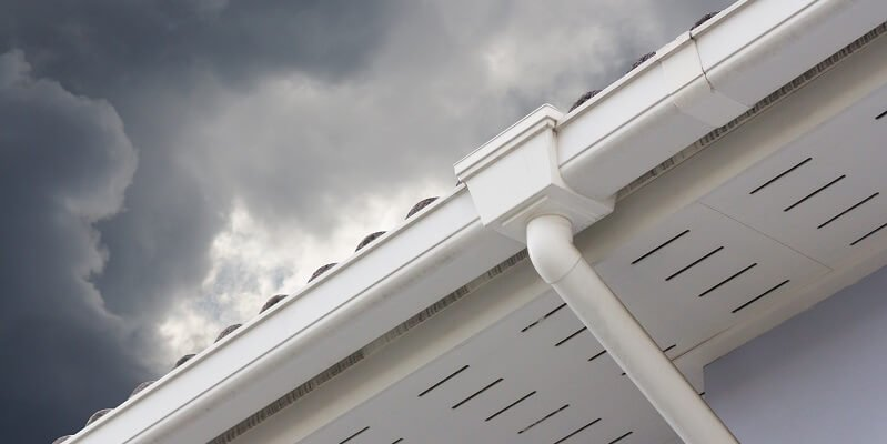 vinyl gutters with vinyl soffit on home