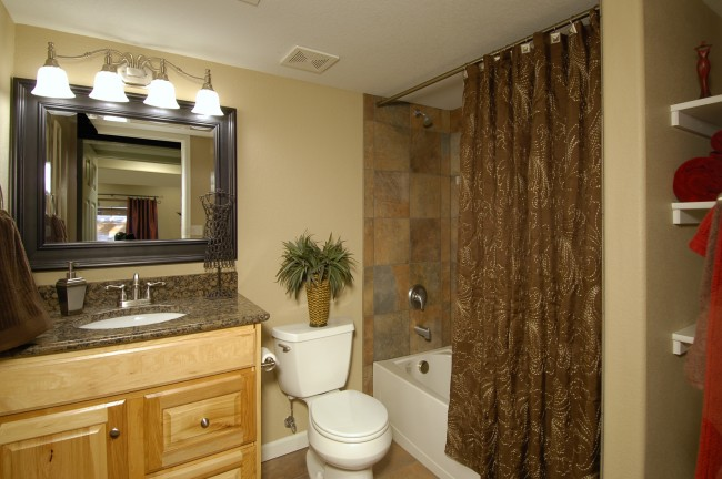 Adding a basement bathroom project guide homeadvisor for Does a walkout basement cost more