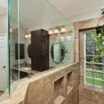Bathroom wall with glass block tiles and mirror