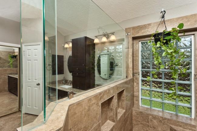 bathroom wall with glass block tiles and mirror - Bathroom Tile Repair