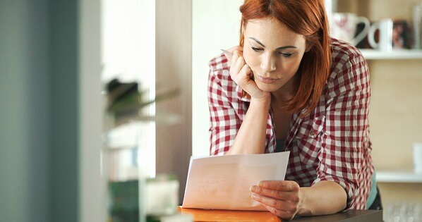 woman arranges home task prioritization for contractor
