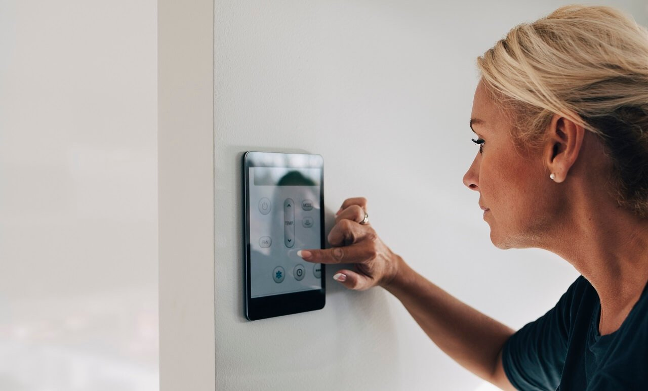 woman updates thermostat