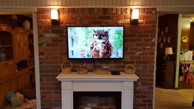 how to mount a tv on your wall a diy guide by homeadvisor rh homeadvisor com Family Room with TV On Wall Decorating Ideas Awesom TV Wall