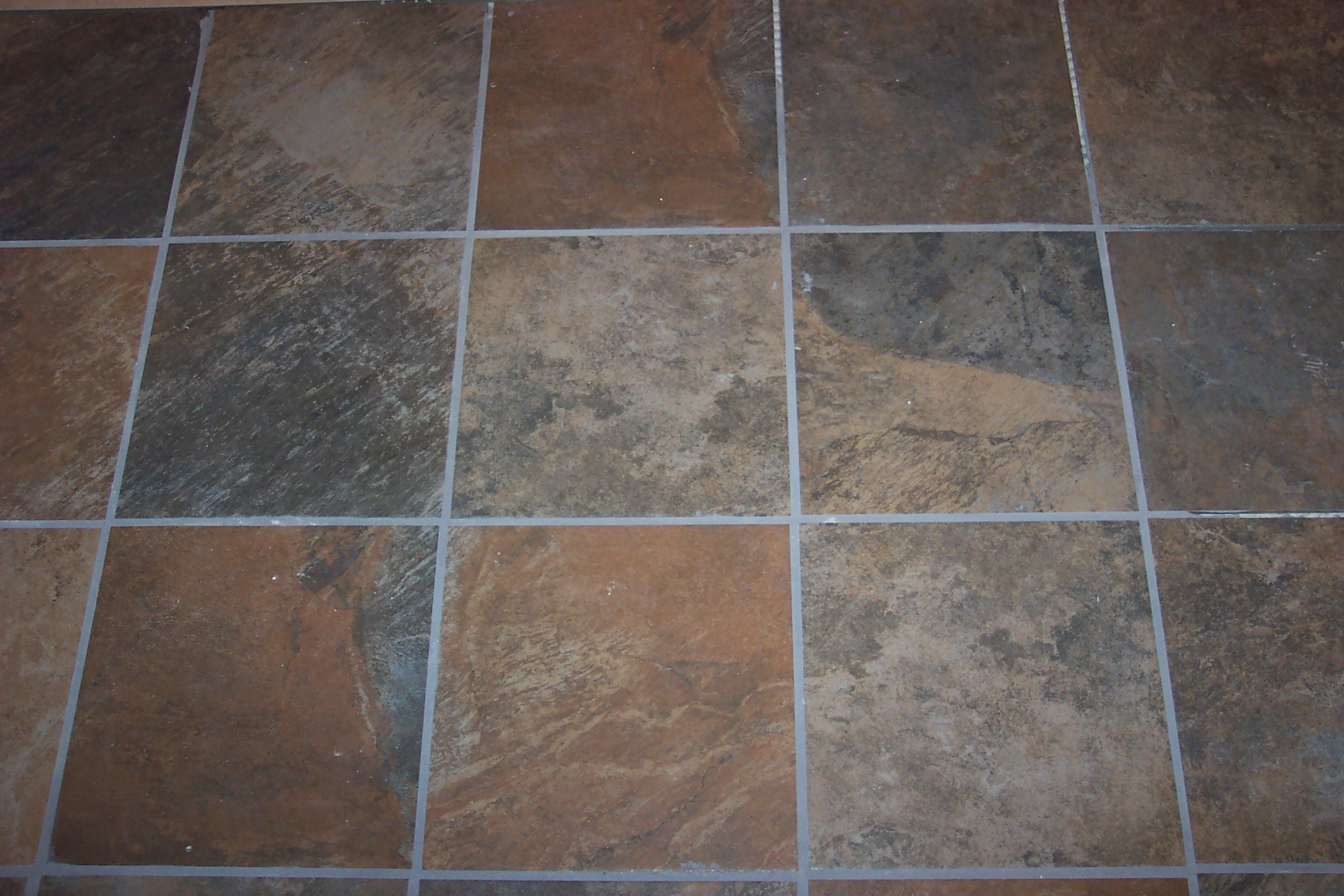 Pros and cons of slate flooring homeadvisor for Floor tiles images