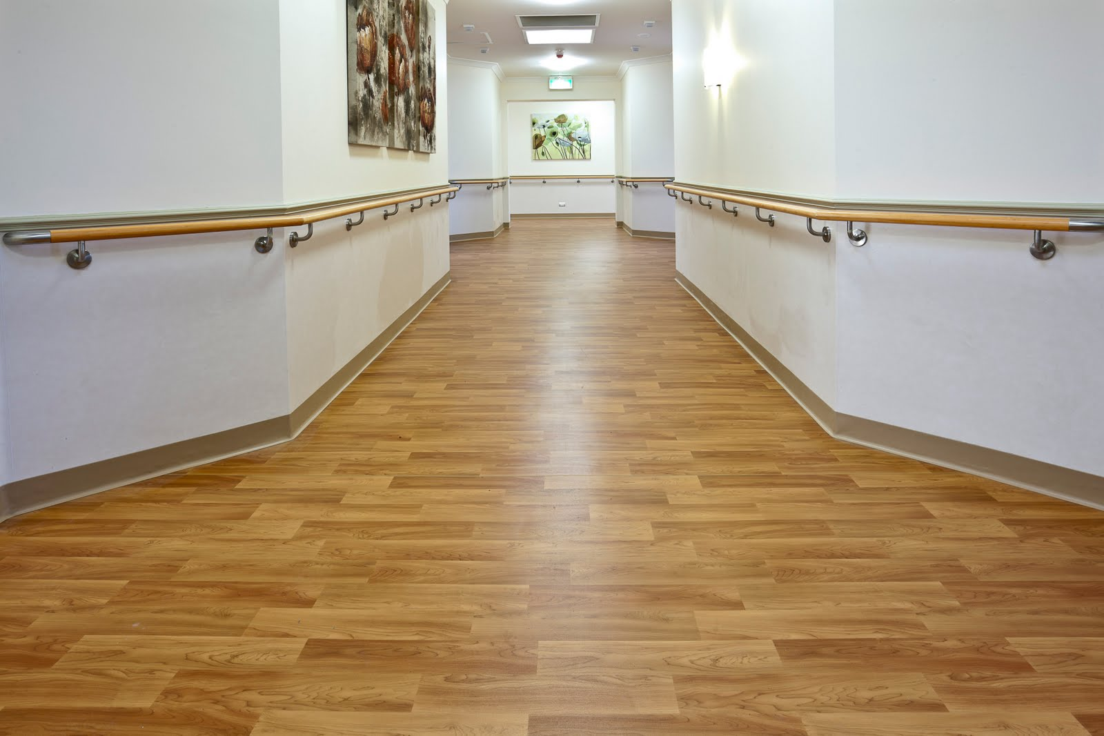 Vinyl flooring pros cons types homeadvisor for Pvc hardwood flooring