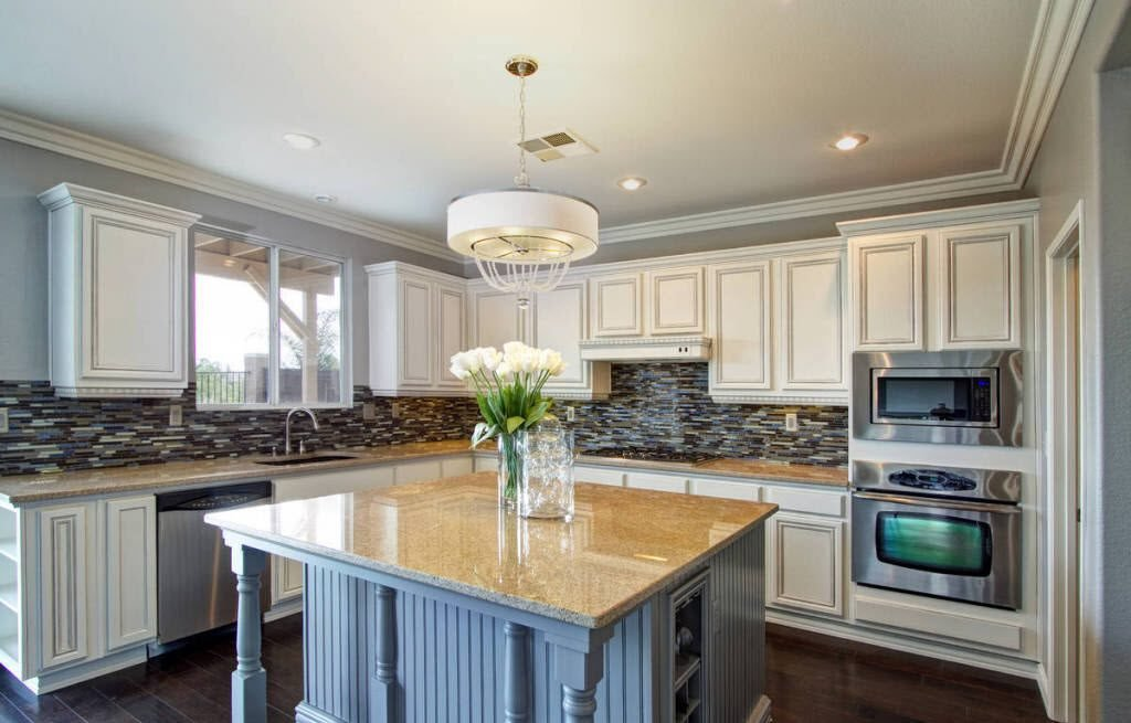Refacing Or Refinishing Kitchen Cabinets HomeAdvisor - Kitchen cabinet painters near me