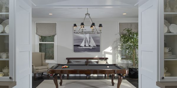 Pool table in white room