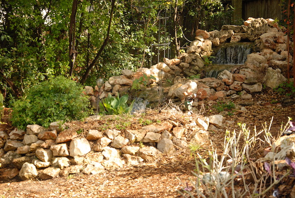 Backyard waterfall on stones