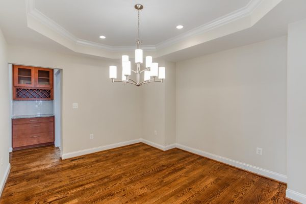 Empty room with white tray ceiling