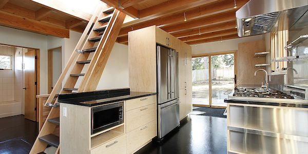 Kitchen with attic stairs