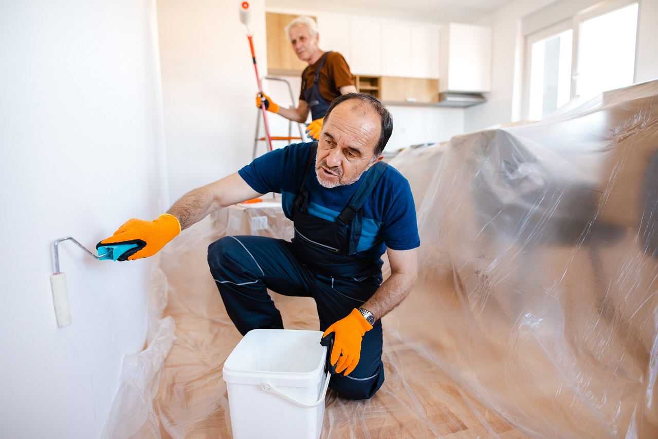 Senior home painters painting the walls in client's apartment