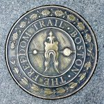 Sidewalk emblem of The Freedom Trail in Boston