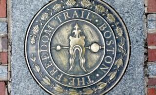 Sidewalk emblem of The Freedom Trail in Boston