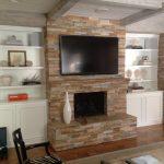 Wood shelves around fireplace