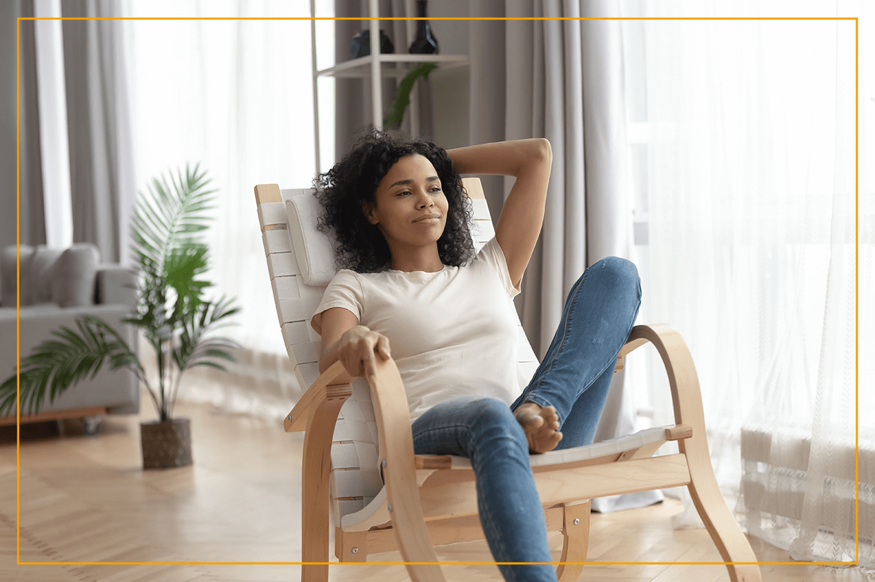 woman sitting in lounge chair