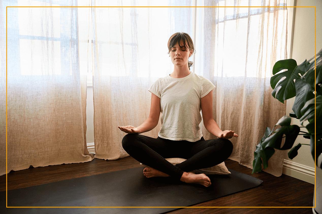 woman in meditation pose on floor