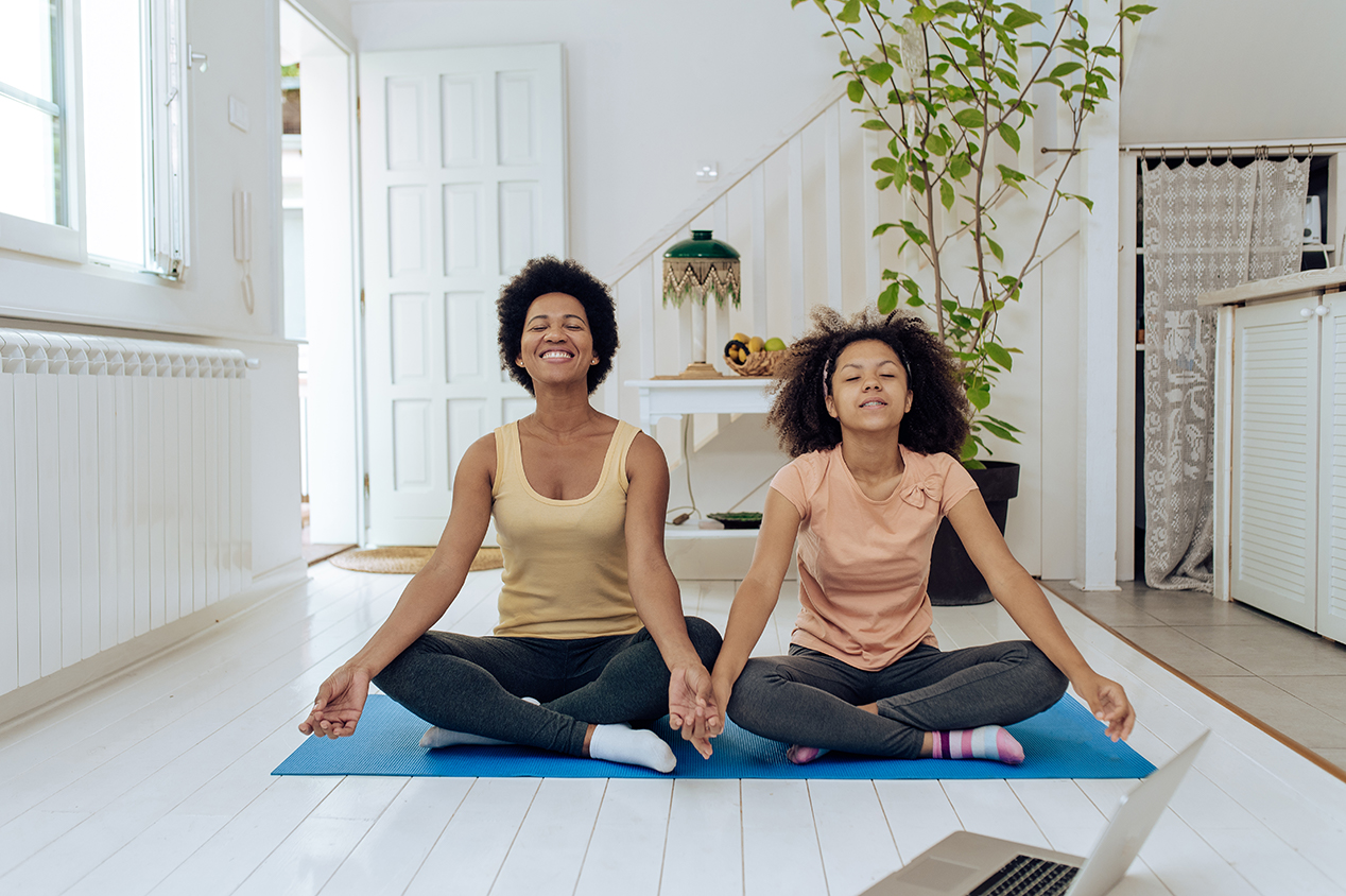 mother and daughter meditation on floor