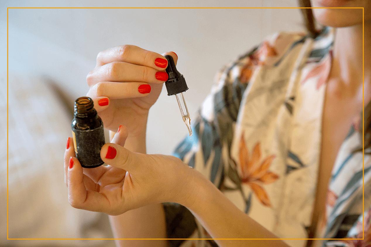 woman using essential oils