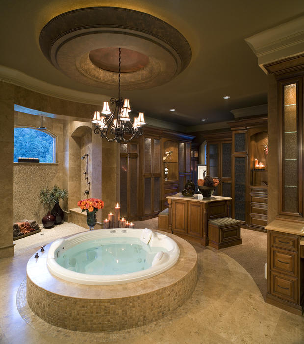 Open round jetted tub with Chandelier