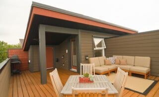 home with shady and furnished wooden deck
