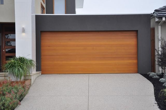 Modern, natural garage door in geometric, color block house