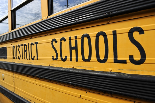 Side of an yellow district school bus