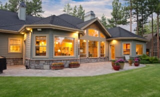 Family home with patio and landscaping in the summer