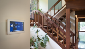 smart home thermostat on wall of seniors home