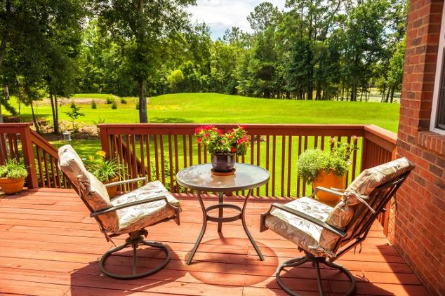 Backyard deck overlooking lake outside residential structure