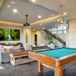 A newly remodeled basement with a pool table