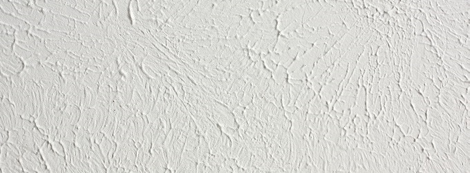 A Background Of Sponge Painted Knockdown Textured White Ceiling In Home
