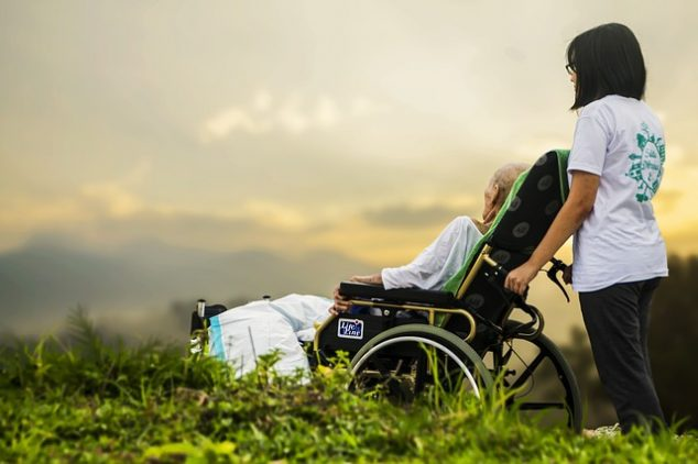 Elderly individual receiving care outdoors