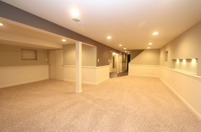 Basement With Separate Rooms, Recessed Lighting, And Beige Carpet.