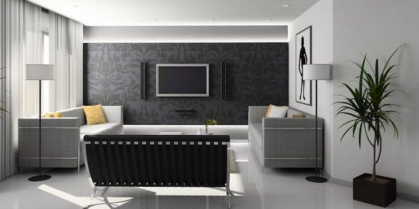 A black and white living room with a smart television and smart speakers.