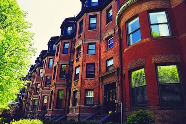 Brown brick exterior row homes in New England.