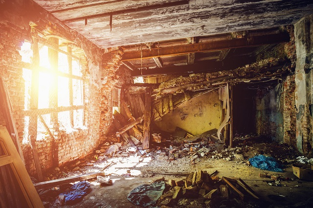 Inside ruined abandoned house building after disaster, war, earthquake, Hurricane or other natural cataclysm.