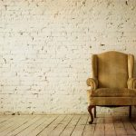 Old Retro Armchair against Blank White Wall