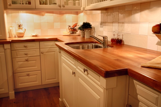 Wood countertops in warm, updated kitchen