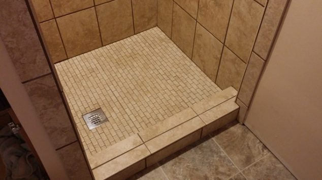 how to build a shower pan install a tile floor homeadvisor. Black Bedroom Furniture Sets. Home Design Ideas