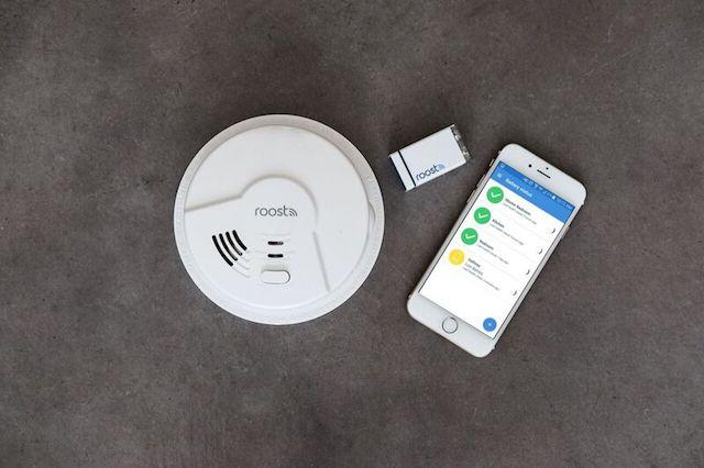 Roost Smart Battery on desk powering phone