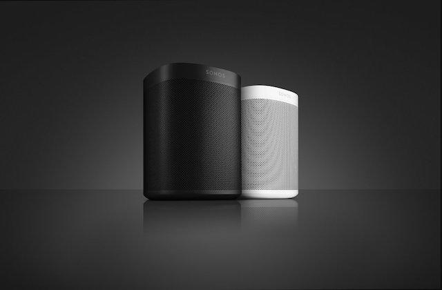 Sonos One device on sleek black surface
